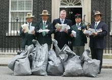 Peter Carroll handing in petitions at 10 Downing Street with retired Gurkhas