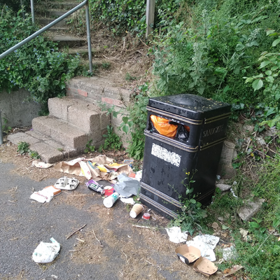 Overflowing waste bin